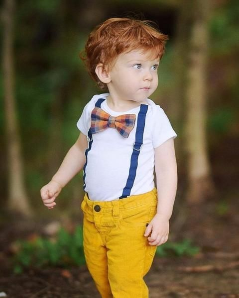 bold yellow jeans, a white tee with blue suspenders and a plaid bow tie for a chic look
