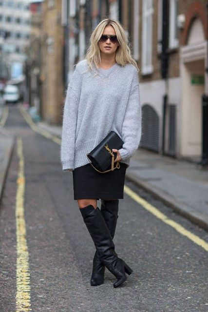 With knee-length skirt, gray loose sweater and clutch