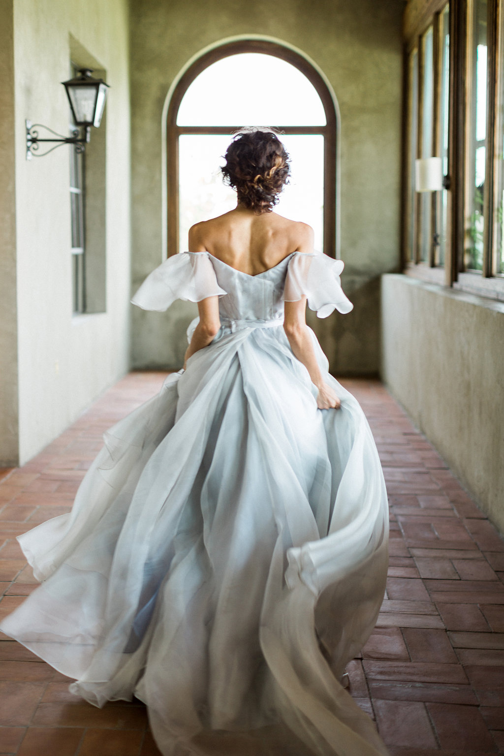 soft blue handpainted wedding gowns - https://ruffledblog.com/cloudy-day-wedding-inspiration-with-a-hand-painted-bridal-gown