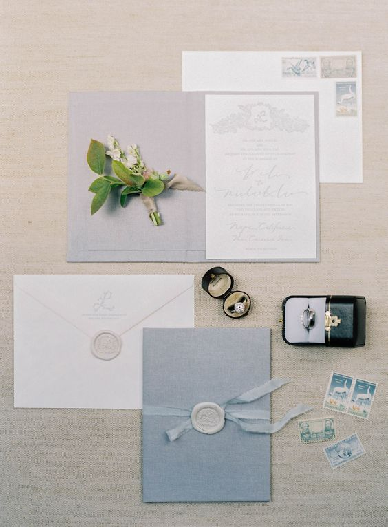 a modern pastel blue invitation set with seals, blue ribbons and pale calligraphy