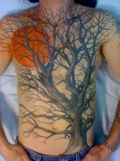 Moon and tree tattoo on the chest and stomach