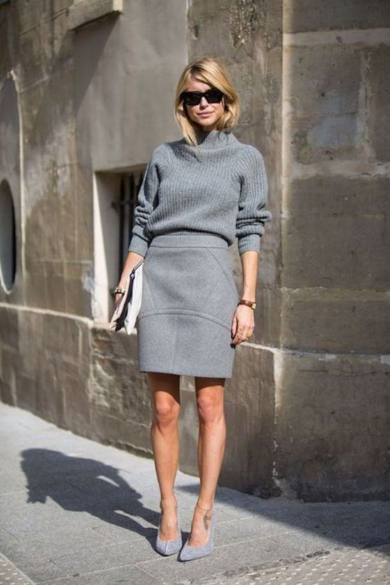 an all-grey look with a sweater, a textural skirt and suede heels