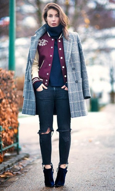 With navy blue turtleneck, bomber jacket, distressed jeans and ankle boots