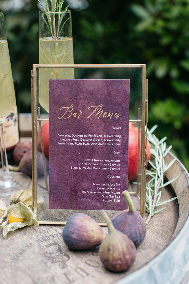 purple wedding paper goods - https://ruffledblog.com/woodland-luxe-wedding-inspiration-with-fall-colors