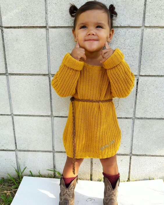 a mustard knit dress with long sleeves, cowboy boots and burgundy socks for a boho feel