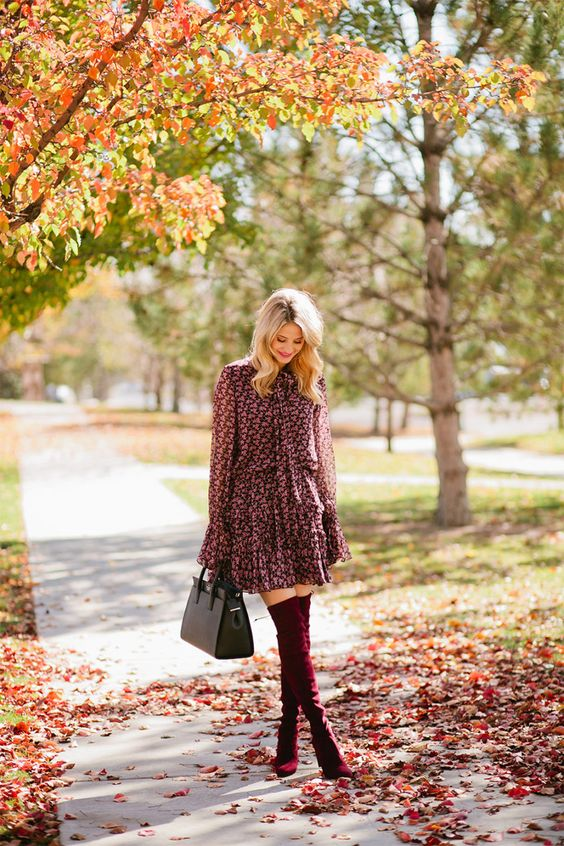a pink floral dress, burgundy tall suede boots and a black bag for a sexy girlish look