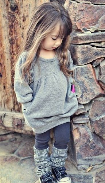 a grey sweater dress, brown leggings, striped legwarmers, sneakers for a cute and comfy fall look