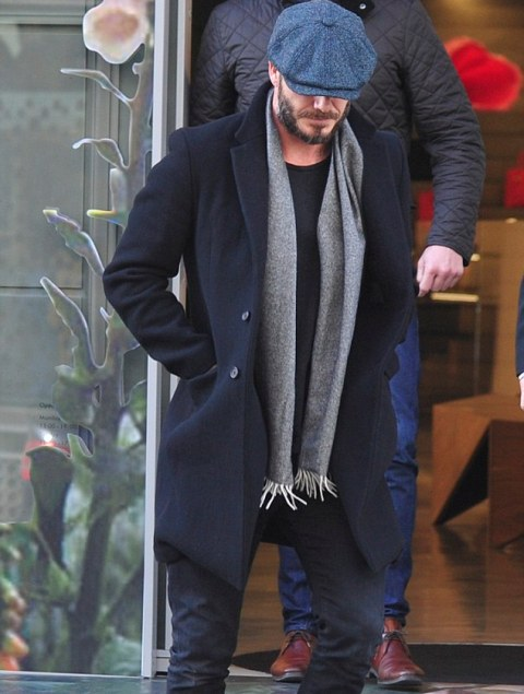 With gray scarf, navy blue coat and jeans