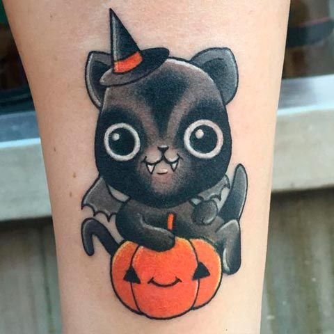 Cute bat with black hat and orange pumpkin tattoo