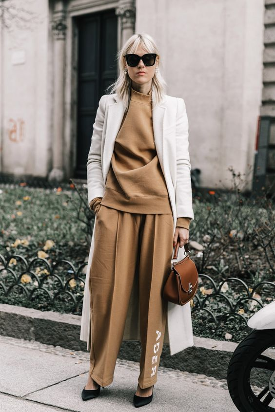 a camel suit, a white coat over it and black heels for a chic fall-inspired outfit