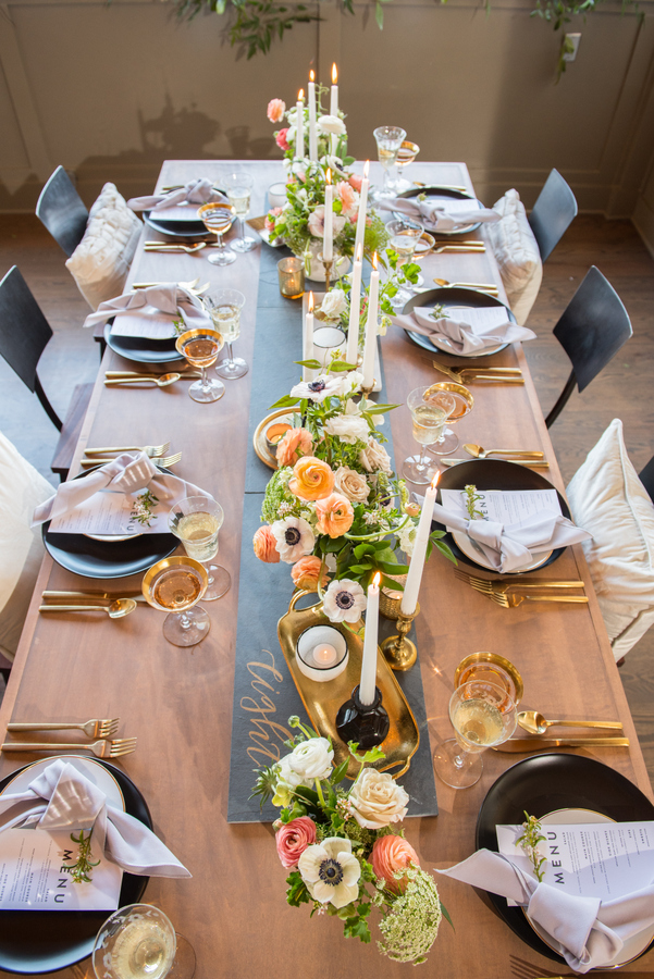 Gold cutlery, gold rimmed glasses, gold candle holders and bowls added glam to the tablescape