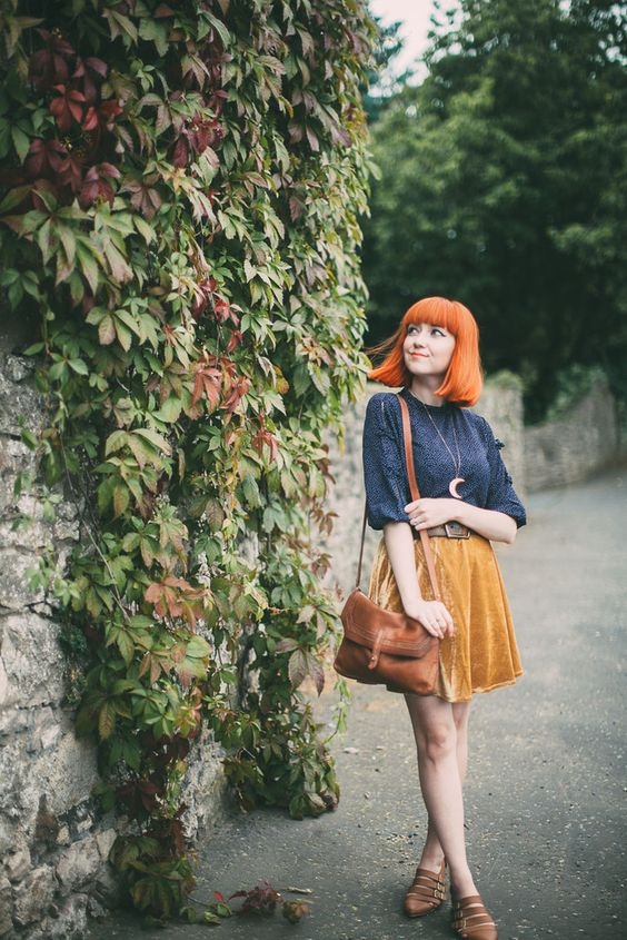 a vintage look with a printed navy shirt, a yellow velvet mini, brown strappy flats and a cognac bag