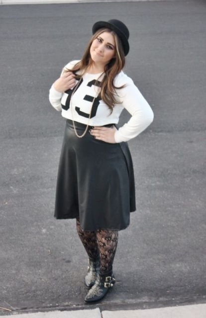 With shirt, leather knee-length skirt and boots