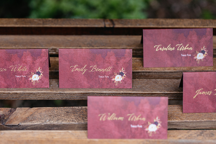 burgundy paper goods - https://ruffledblog.com/woodland-luxe-wedding-inspiration-with-fall-colors