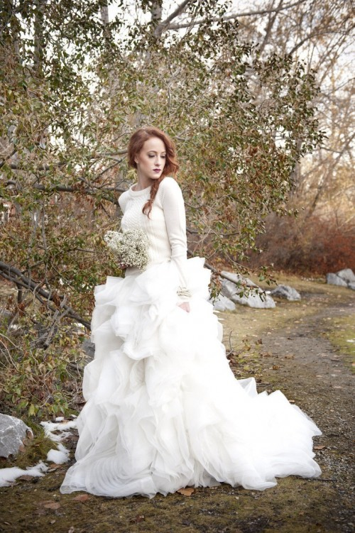 a neutral sweater over the wedding dress looks feminine and winter-like