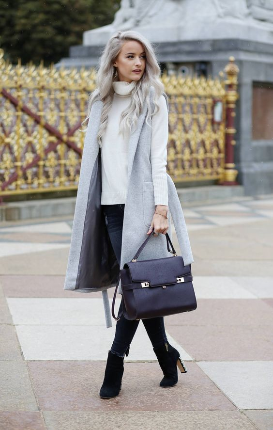 navy jeans, a white sweater, a grey sleeveless coat and black suede booties
