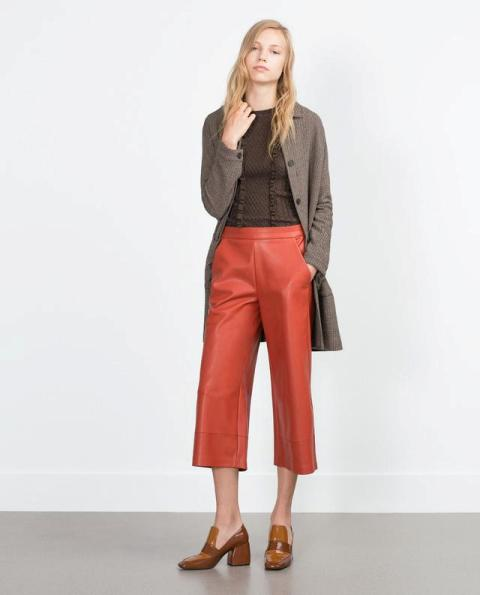 With brown shirt, long cardigan and brown boots