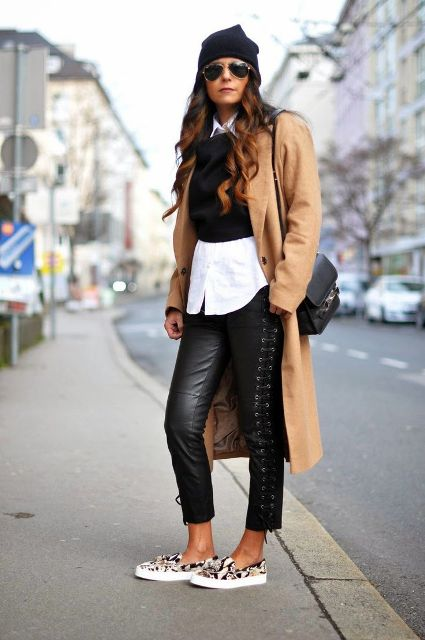With white shirt, black vest, printed slip on shoes, camel midi coat and hat