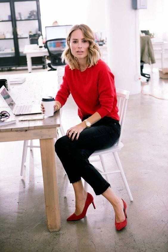 a red sweater and shoes plus black denim for a creative job outfit