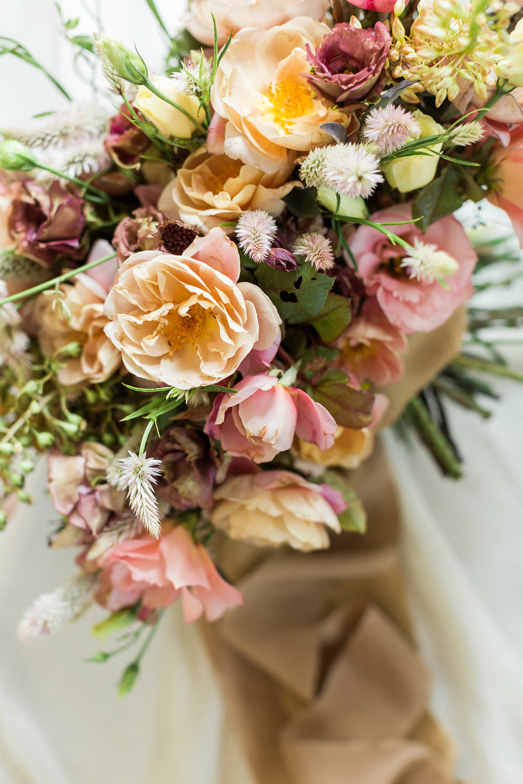 peachy pink wedding bouquets for fall - https://ruffledblog.com/cloudy-day-wedding-inspiration-with-a-hand-painted-bridal-gown