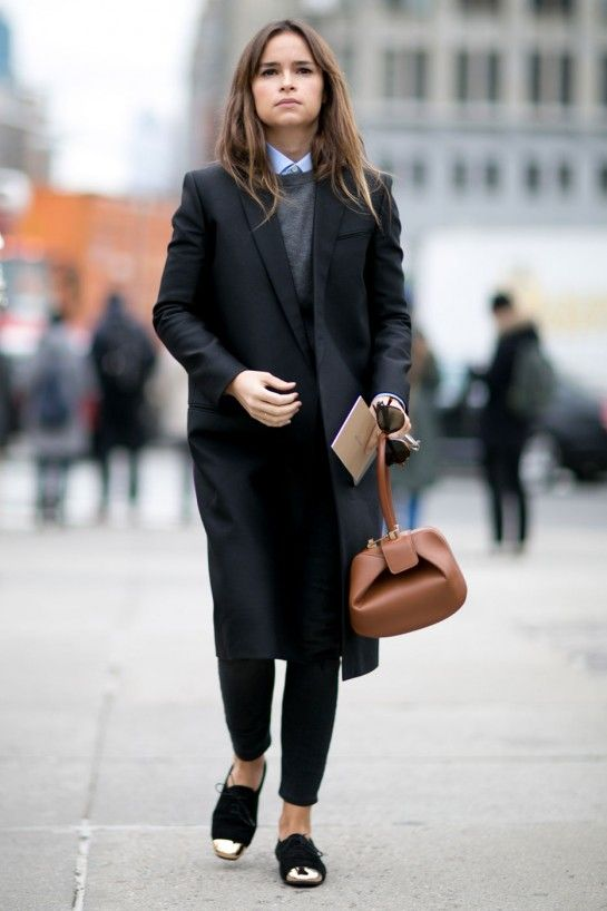 black jeans, a grey sweater over a blue shirt, a blak jacket coat and black flats