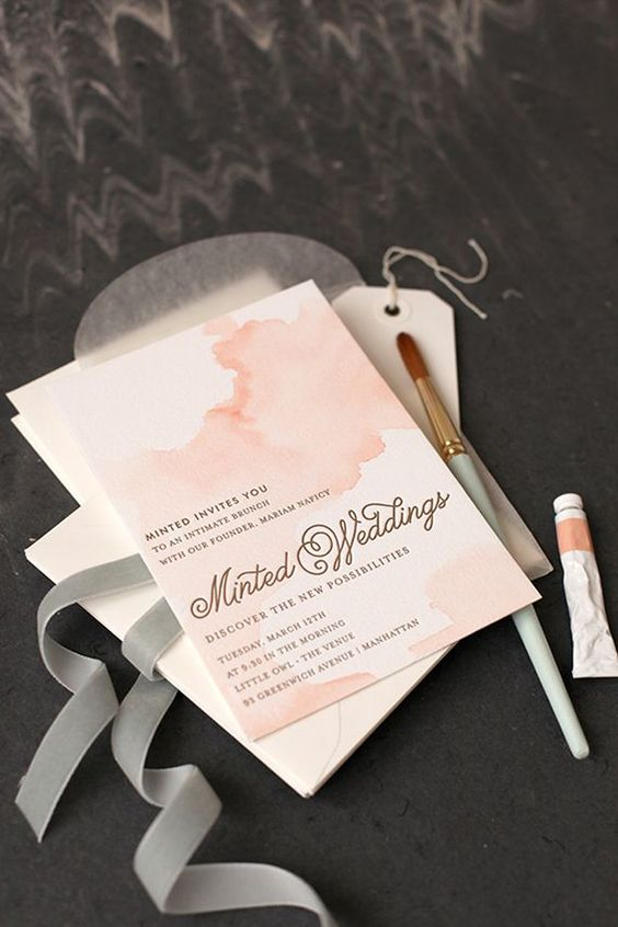 watercolor pastel pink wedding invitations in simple white envelopes