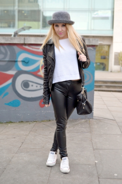 With white sweatshirt, leather pants, white sneakers and black bag