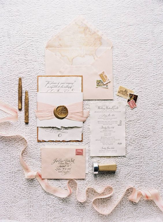 blush wedding stationery with watercolor prints, blush ribbons and seals for a sweet and chic wedding