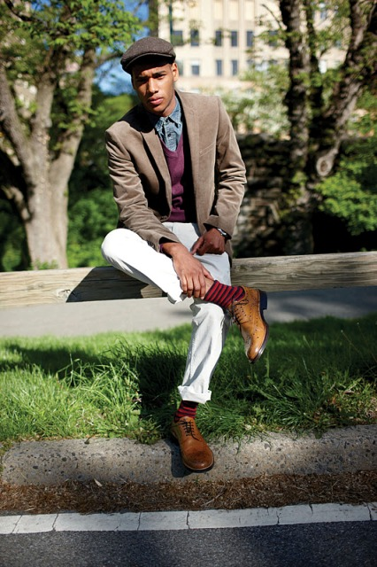 With denim shirt, purple vest, light brown jacket, white pants and brown shoes