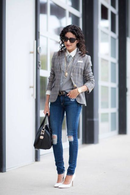 With striped shirt, distressed jeans, white pumps and black bag
