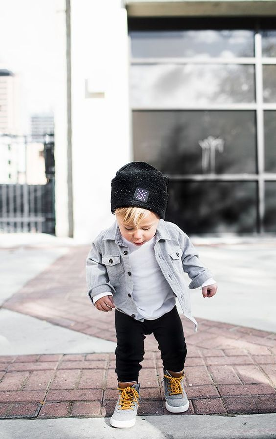 black pants, a white tee, a bleached denim jacket, grey sneakers, a black beanie to feel warm and cozy