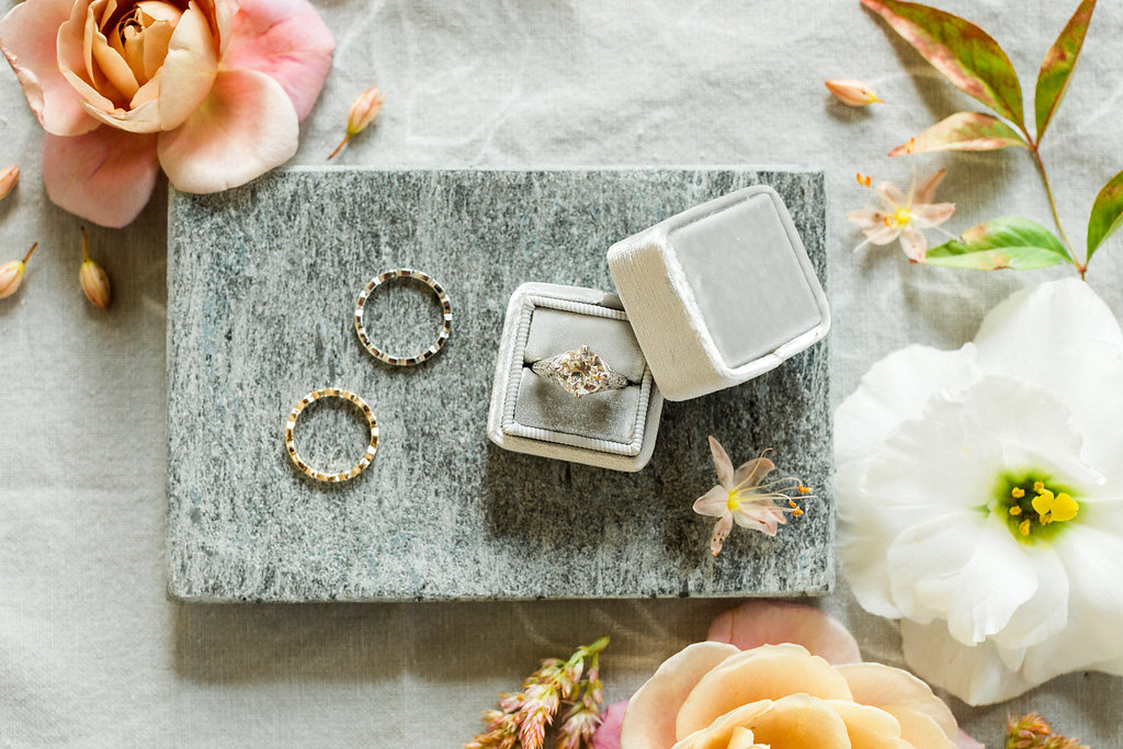vintage inspired engagement rings - https://ruffledblog.com/cloudy-day-wedding-inspiration-with-a-hand-painted-bridal-gown