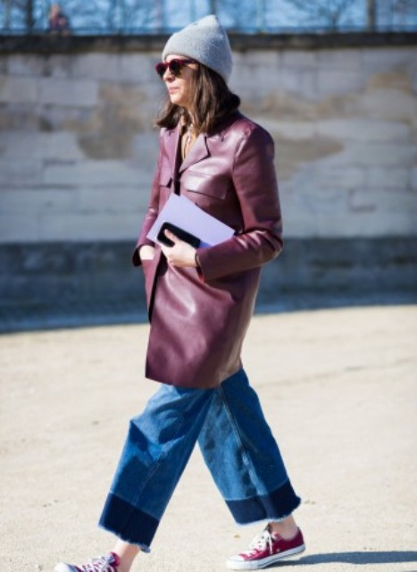 With marsala coat, sneakers and gray hat