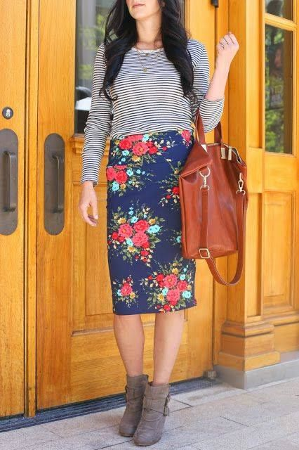 a blue floral pencil skirt, a striped top, brown suede booties and a burnt orange bag