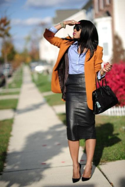 a black pencil skirt, a blue shirt, a mustard jacket and black shoes for work