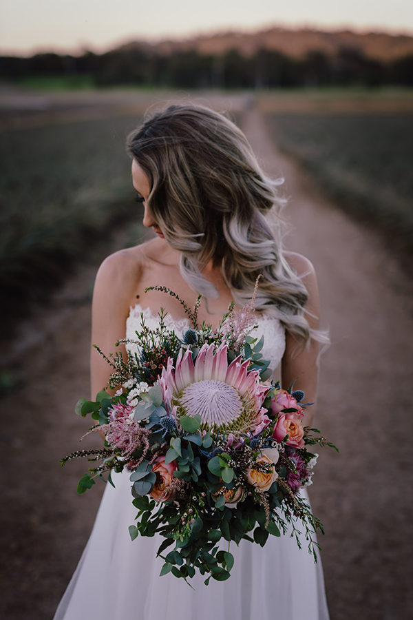 Loving these protea bouquets #wedding #bride #bouquet