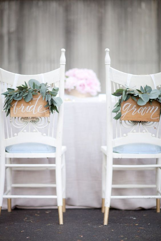cute wooden signs with fresh eucalyptus are a chic idea for any wedding