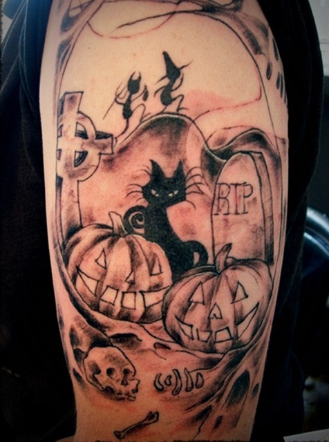 Half-sleeve black cat, pumpkins and skull tattoo