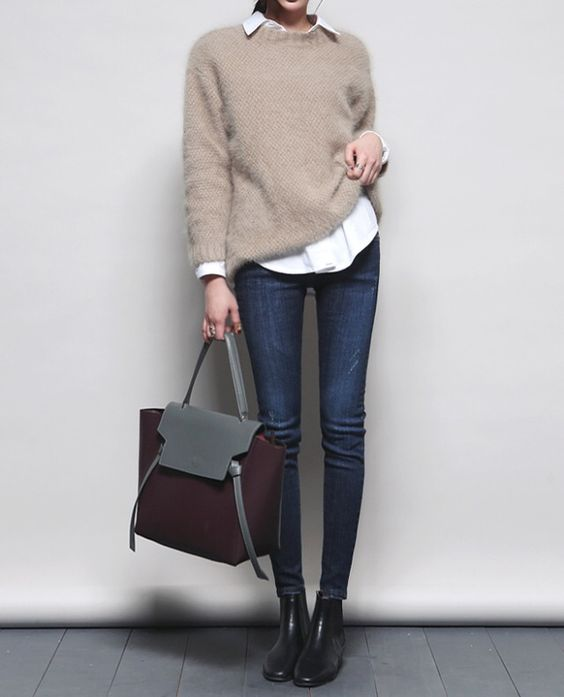 a casual Friday look with a white shirt, a beige sweater, navy skinnies, black booties and a burgundy bag