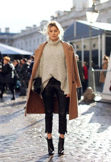 With oversized sweater, black ankle boots and camel coat