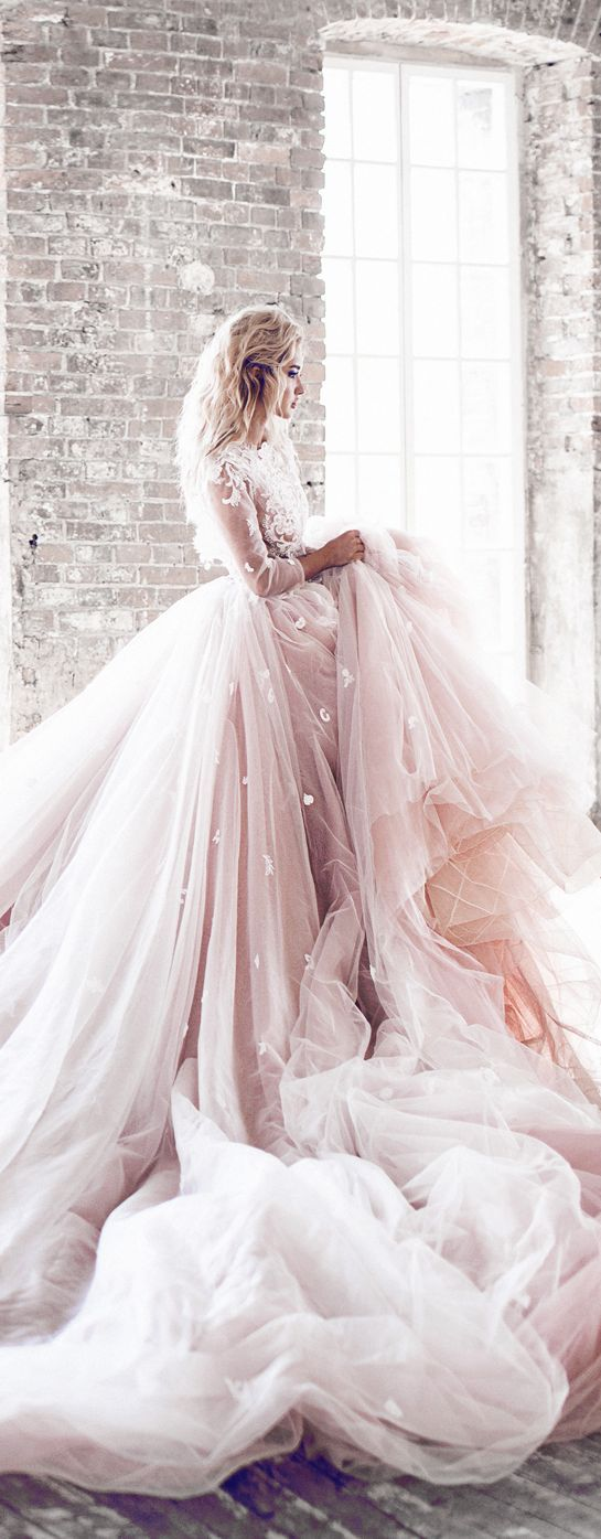 pink princess wedding gown with a full layered skirt, long sleeves and white floral lace appliques