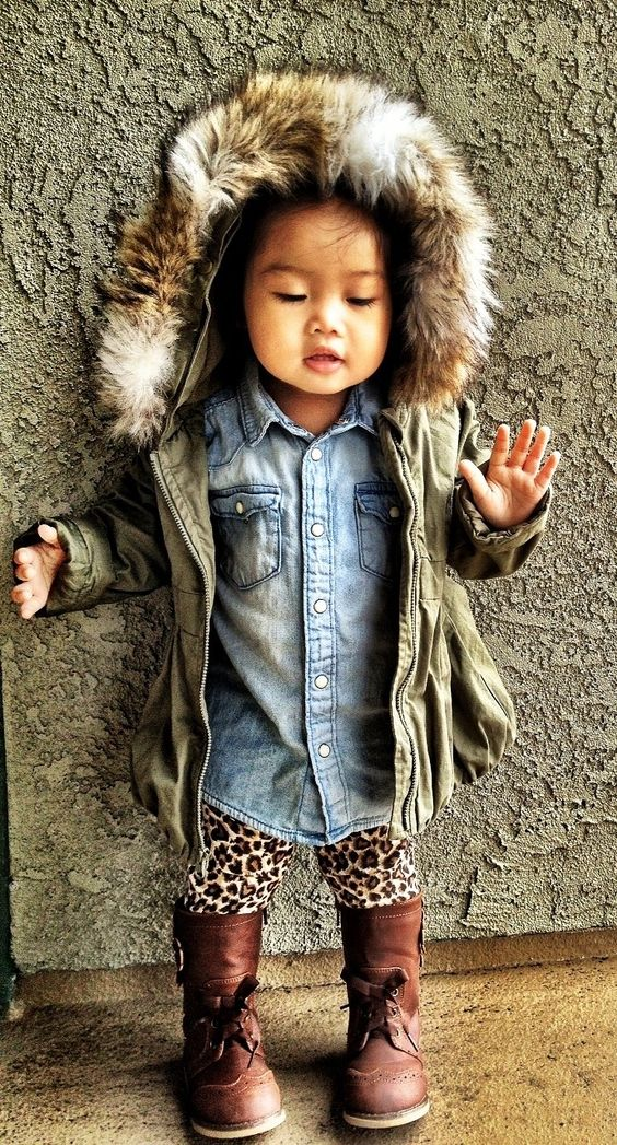 an olive green parka with faux fur, denim and a leopard print for a bold look