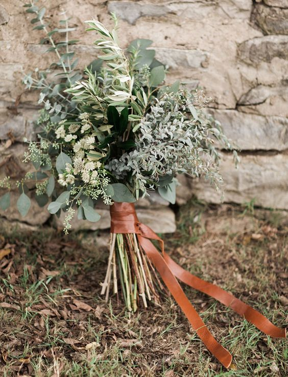 a leather wrapped greenery bouquet for an industrial or modern bride