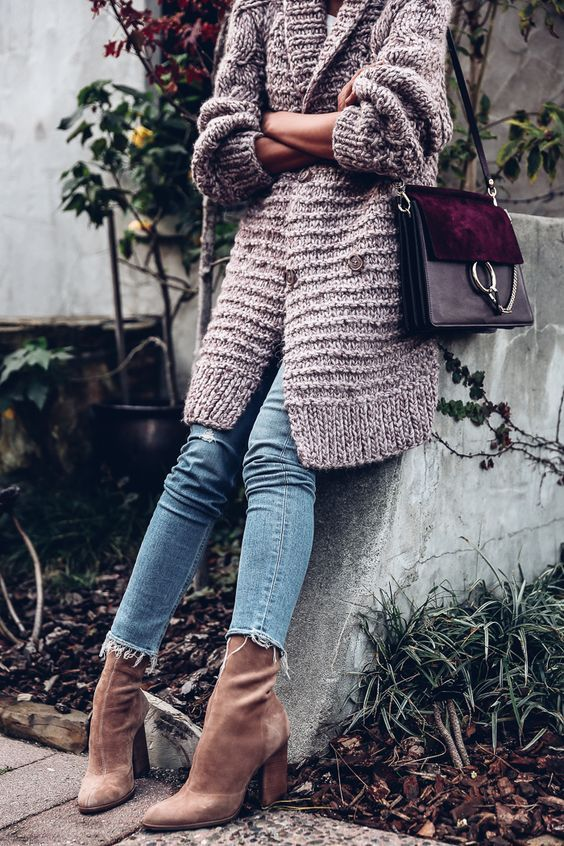 a blush chunky cardigan, cropped jeans, amber velvet sock boots