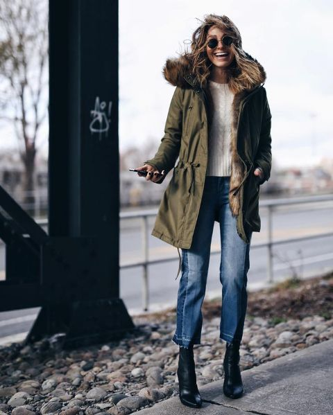 With white sweater, crop jeans and mid calf boots