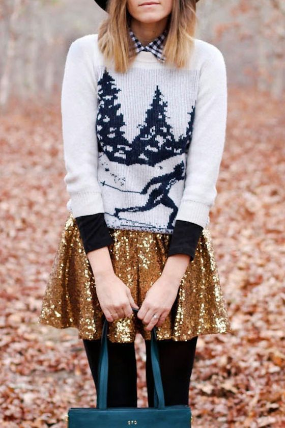 a printed ski sweater over a plaid shirt, a gold sequin skater skirt and black tights