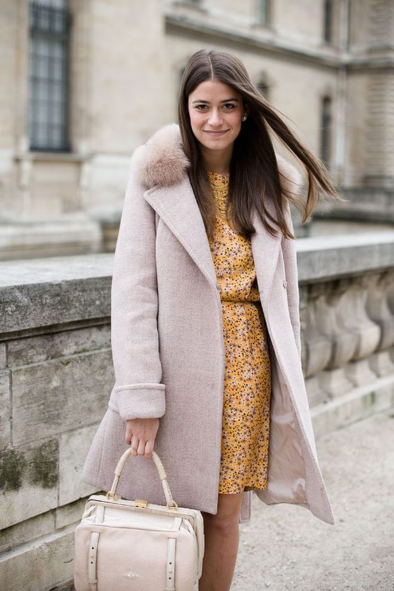 a blush winter coat with a faux fur collar for a girlish winter look