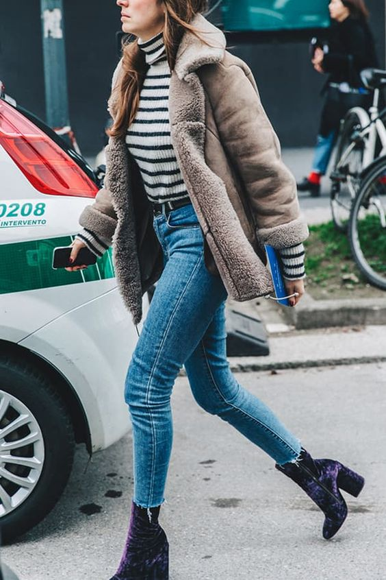 cropped jeans, a striped turtleneck, a shearling coat and purple crushed velvet boots