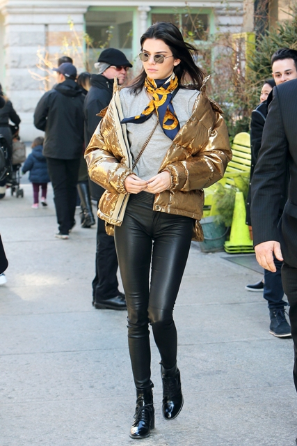 With gray shirt, puffer jacket, printed scarf and ankle boots