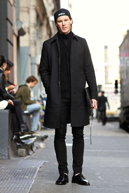 Black cardigan, coat, trousers, shoes and cap